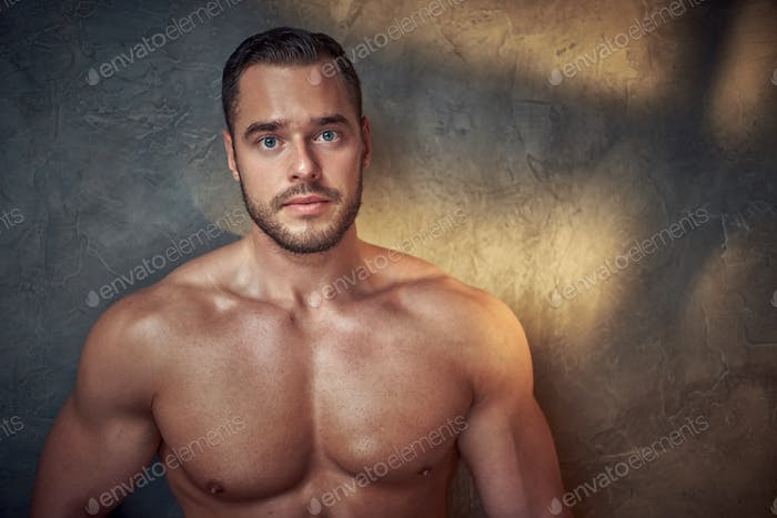Portrait of attractive naked bodybuilder