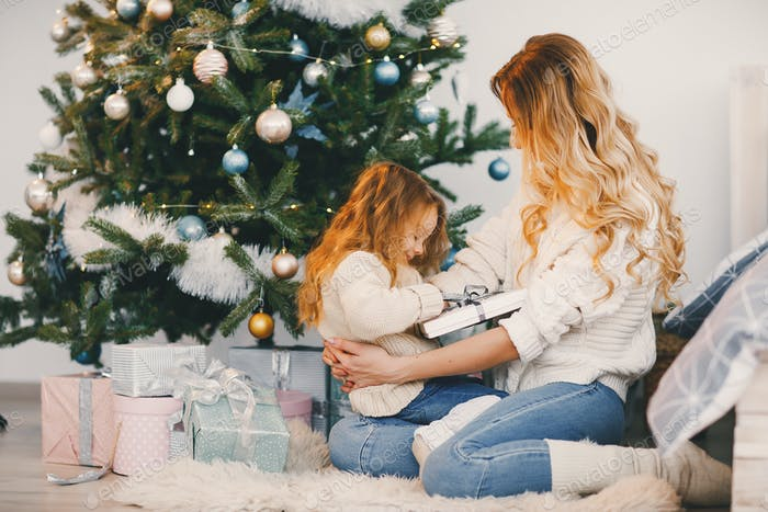mommy and daughter wrapping gifts