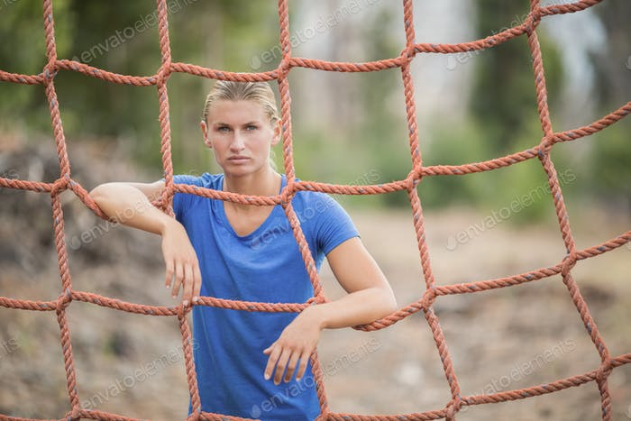 Fit woman standing near fitness trial at boot camp