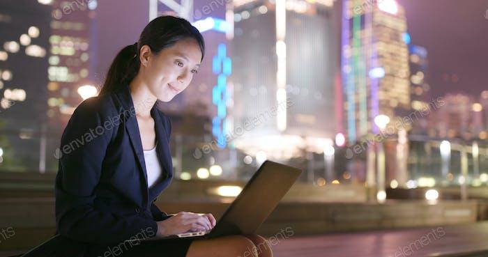 Businesswoman working laptop computer at night