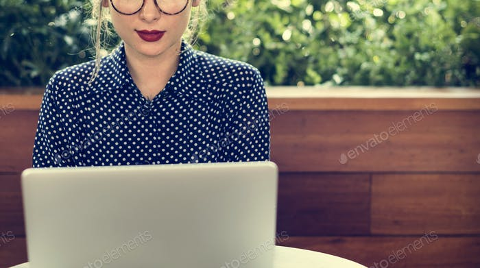 Woman Sitting Alone Using Laptop Concept