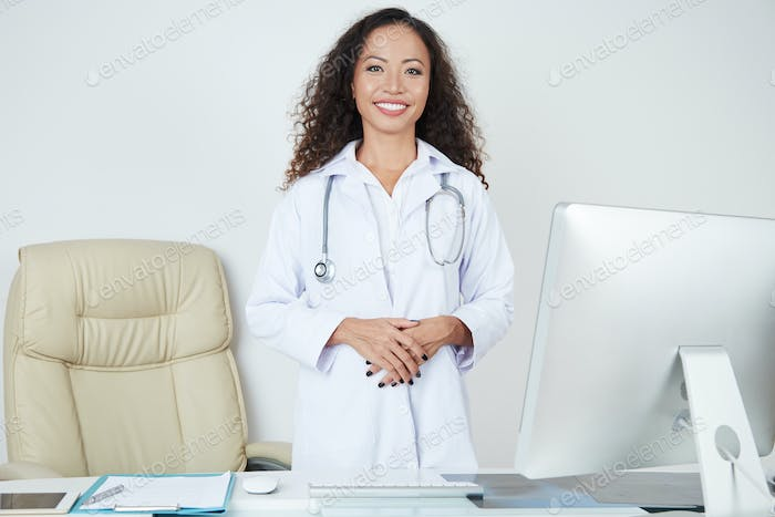 Doctor standing at her workplace