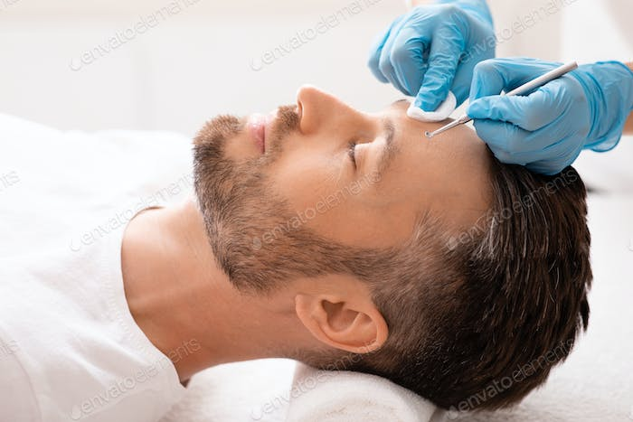Face cleaning procedure for middle-aged handsome man