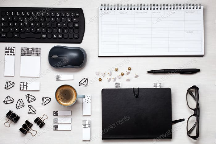 Placeit. Overhead view to various office supplies. Flat lay with mockup planner