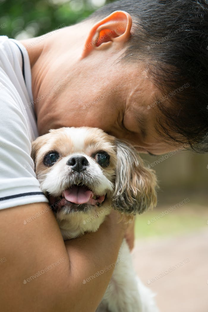 Asian young man with his Shih Tze dog