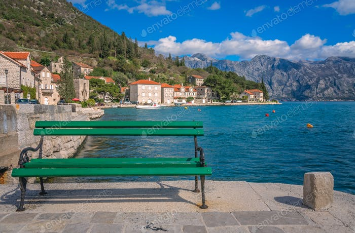 Empty bench on the  shore in Perast town