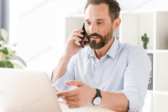 Handsome businessman talking on mobile phone