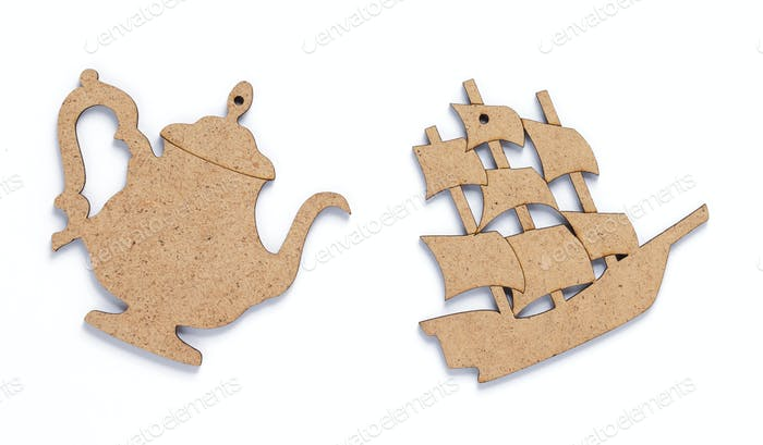 wooden ship and tea pot toy at white background