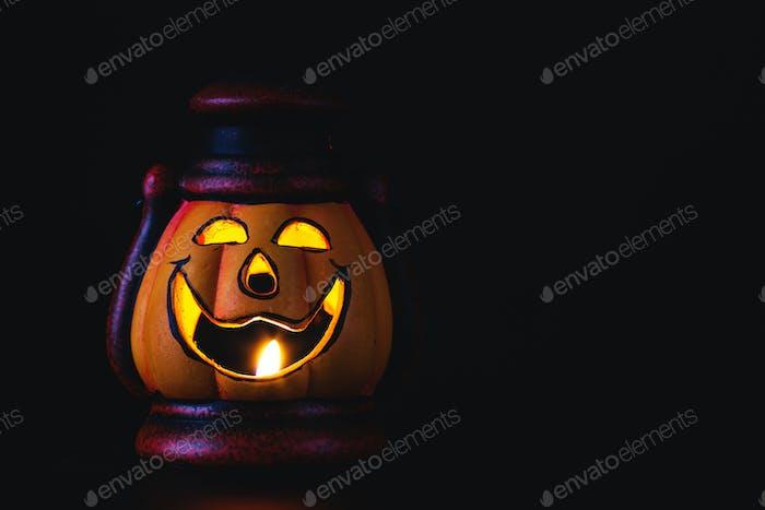 Jack O Lantern halloween pumpkin on black background