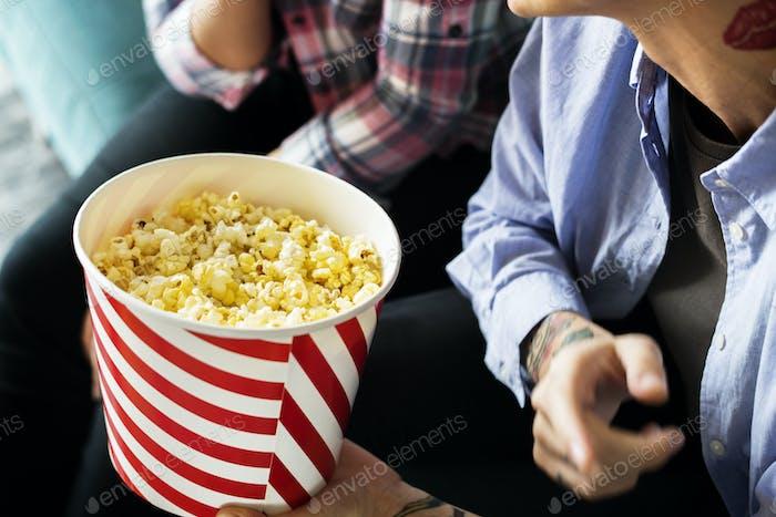 Friends enjoying a movie on friday night