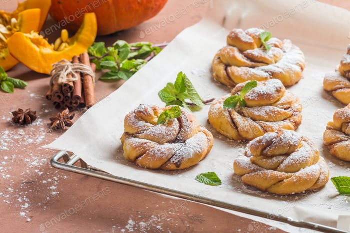 Homemade cinnamon buns with pumpkin