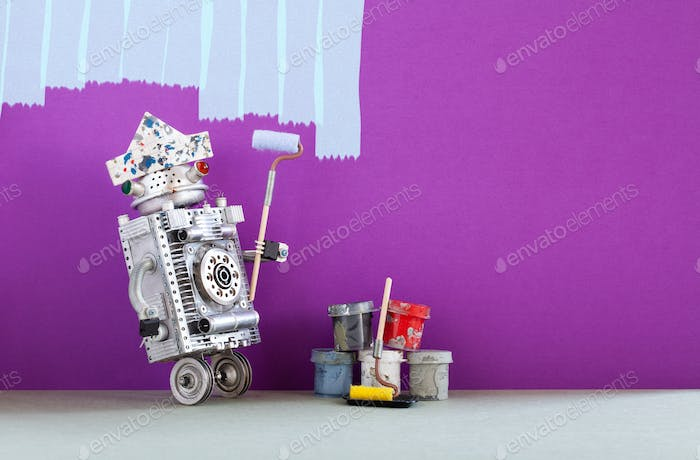 Robot painter at work. Funny decorator with paint roller and buckets