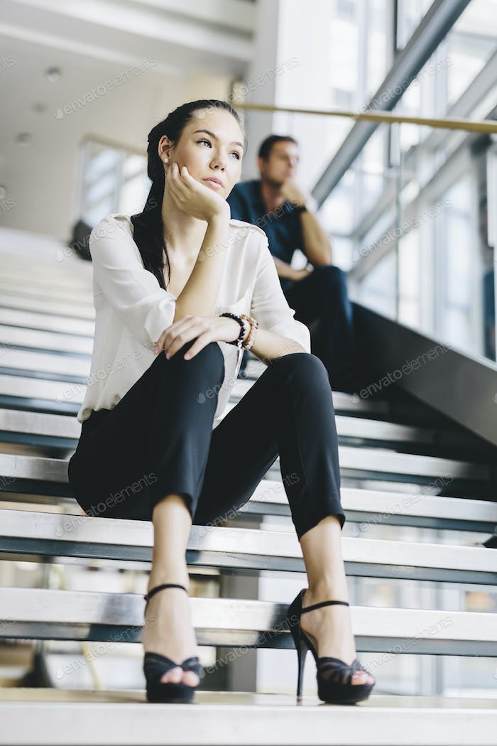 Business people sitting on stairs