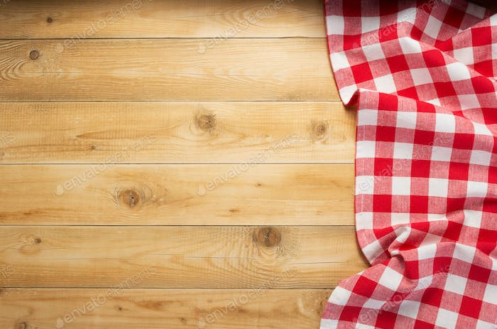 cloth napkin at rustic wooden background, top view