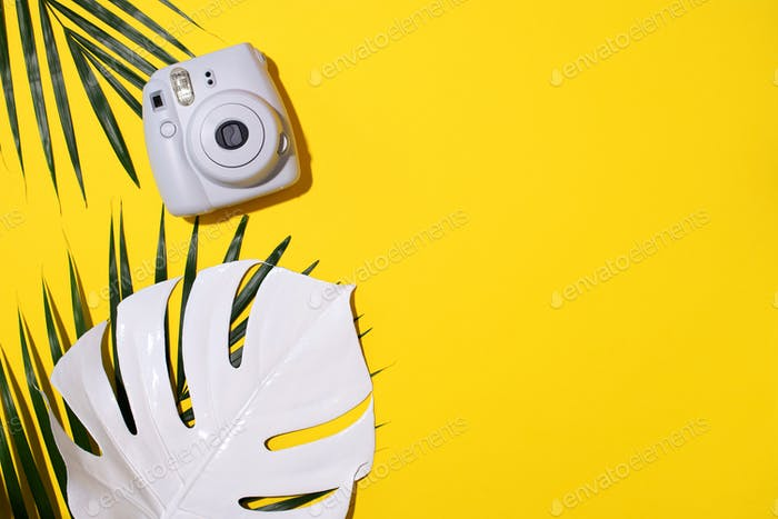 Vilnius, Lithuania - September 16, 2019: FUJIFILM INSTAX Mini Instant Film Camera on yellow