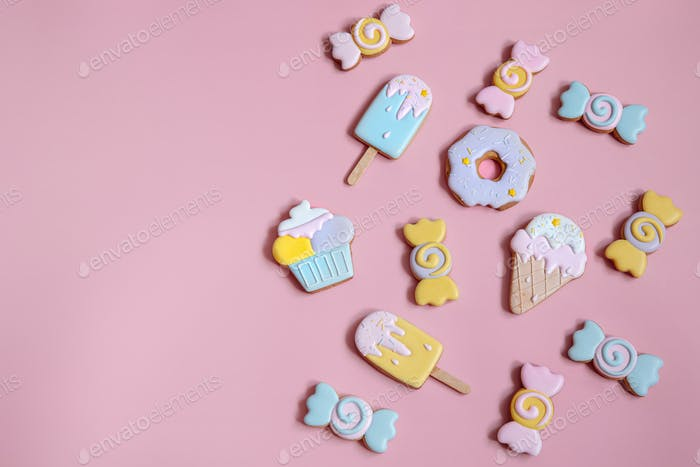 Colorful gingerbread cookies in colored glaze of different shapes.