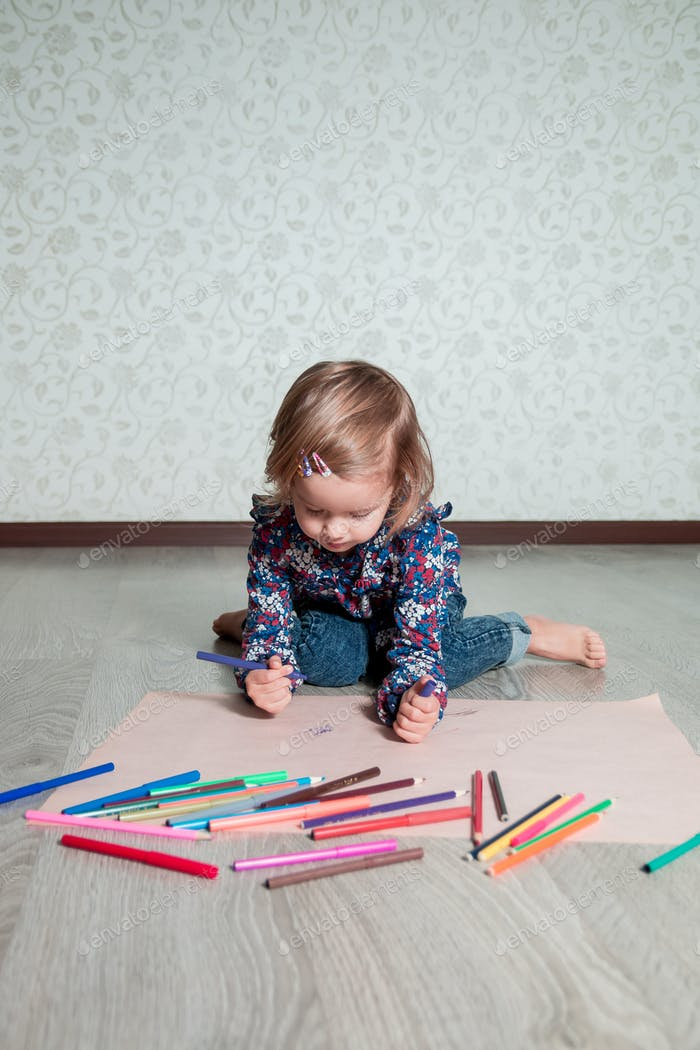 Little girl drawing, painting.