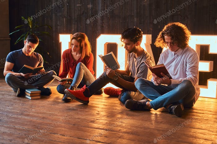 International group of students with books in room decorated illumination