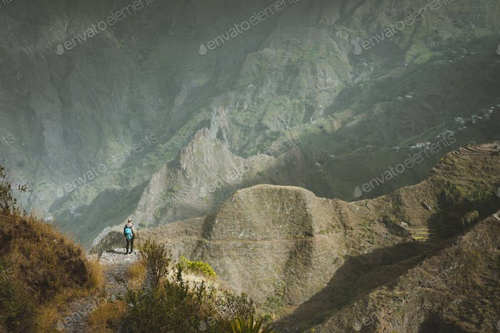 Santo Antao Island Cape Verde. Female hiker enjoying breathtaking view of mountain edges and deep