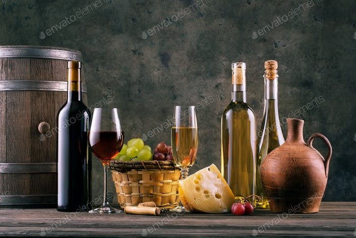 Wine still life with glasses of bottles and grapes