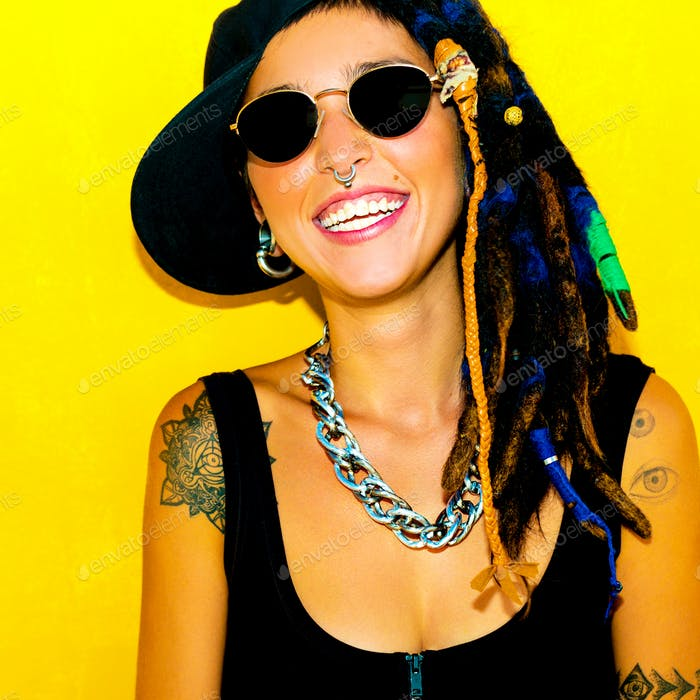 Bob Marley Style Happy Free Girl. Dreadlocks and Tattoos