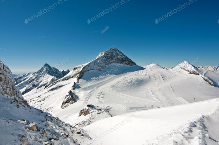 Winter scenic landscape with ski and snowboard slopes on a glaci