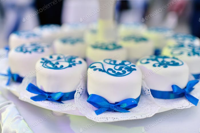 Beautiful wedding cake for bride and groom indoors