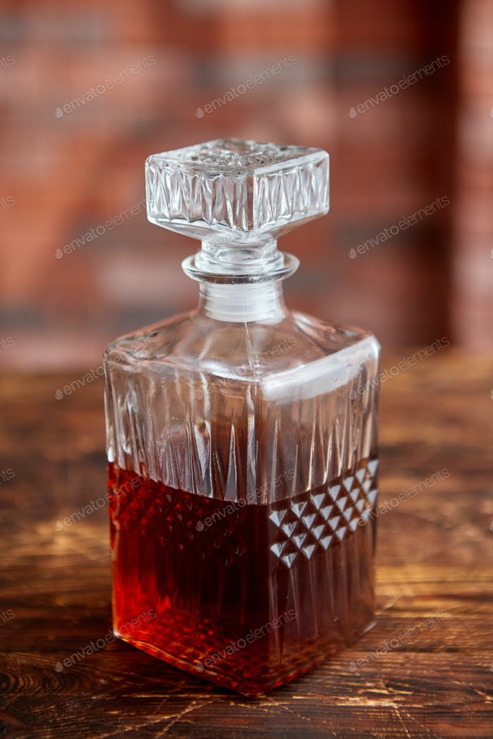 Elegant carafe filled with whiskey, bourbon or rum