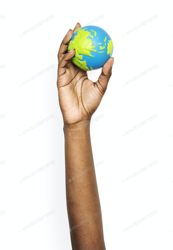 Hand holding a globe ball