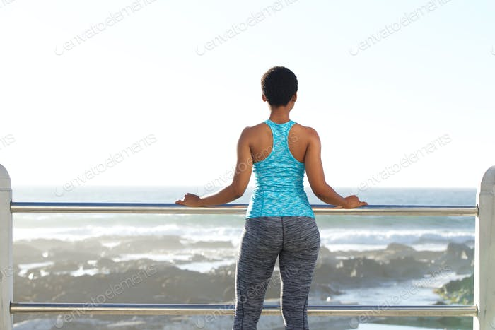 African american woman looking at view of the sea
