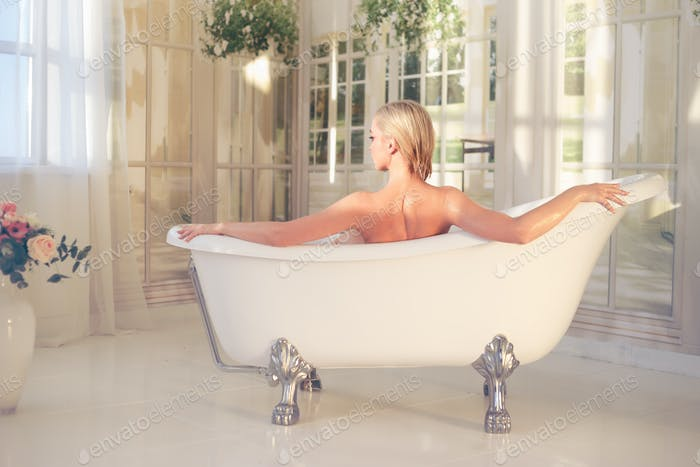 Beautiful nude sexy woman in the bath
