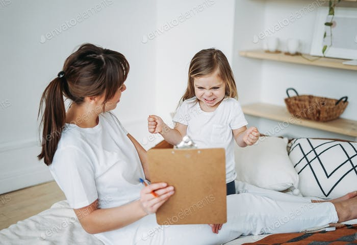 Mother and daughter playing, girl is angry, she lives negative emotions