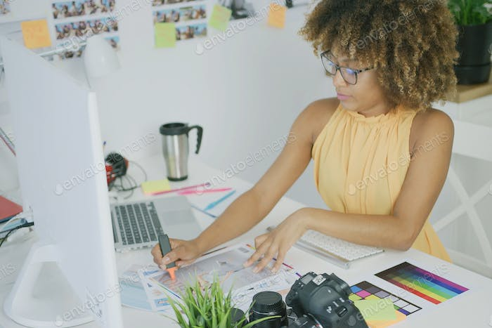 Confident woman working with photos