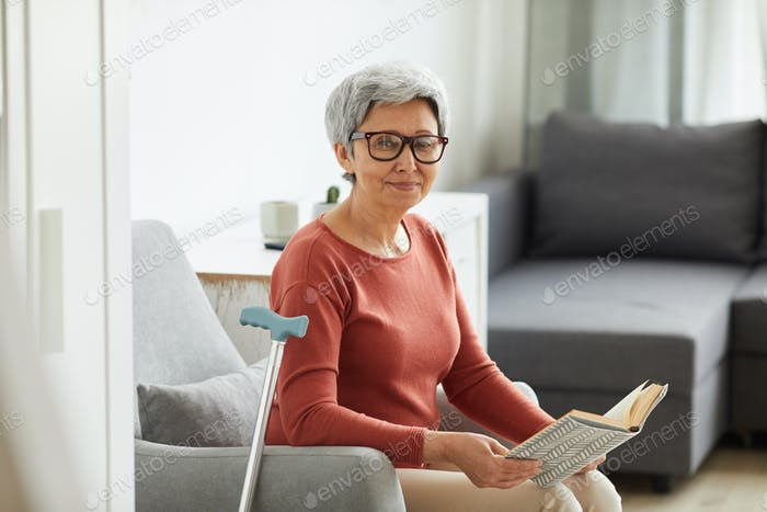 Woman resting with book at home