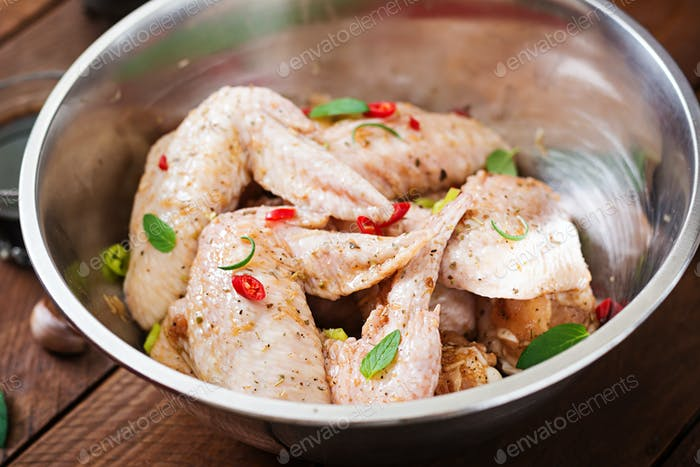 Raw marinated chicken wings prepared in Asian style with honey, garlic, soy sauce and herbs