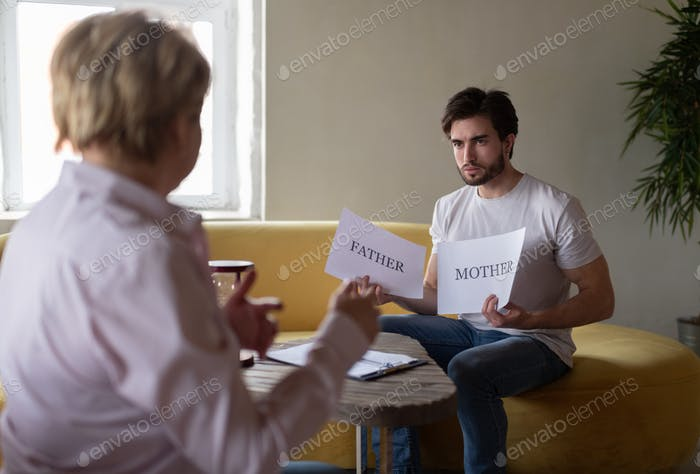 Man revealing family issues during visit to psychologist