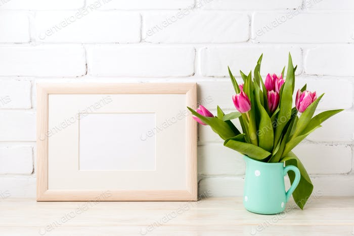 Wooden landscape frame mockup with pink tulips in jug