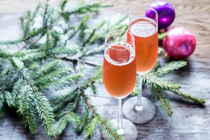 Two glasses of champagne with Christmas tree branch