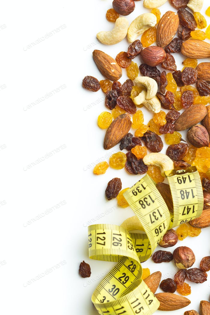 Various nuts and raisins with measuring tape.