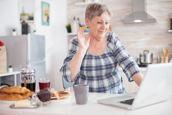 Senior woman saying hello