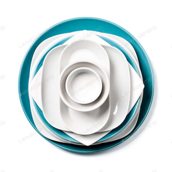 A stack of white and blue porcelain utensils on a clean white ba