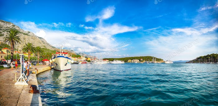 Famous Adriatic resort Makarska with picturesque harbor and touristic boats