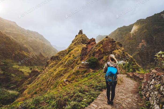 Santo Antao Island Cape Verde. Tourist girl with backpack walking down along the trekking route to