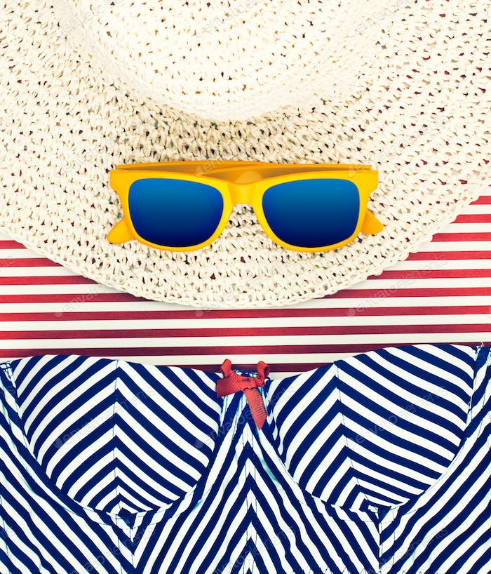 Sunglasses on Hat with Striped Shorts Still Life
