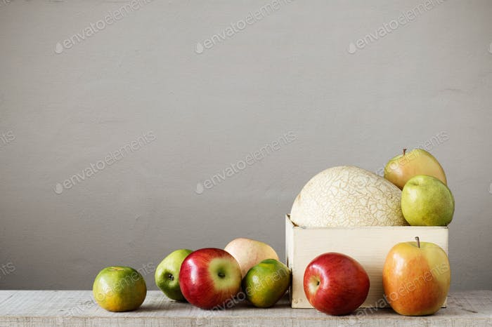 fruits in a tray on wooden