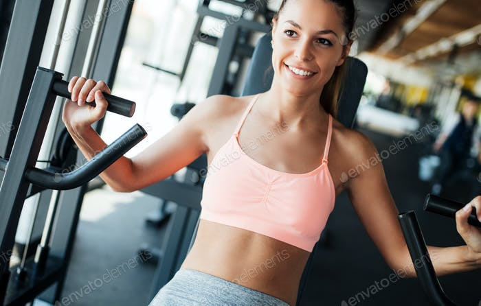 Beautiful young woman doing exercises for chest