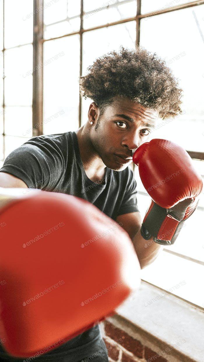 Fighter with red boxing gloves