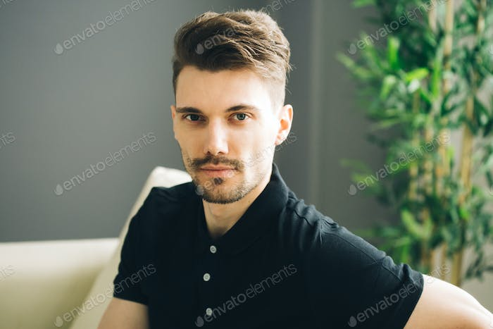 Handsome man portrait casual home in glusses