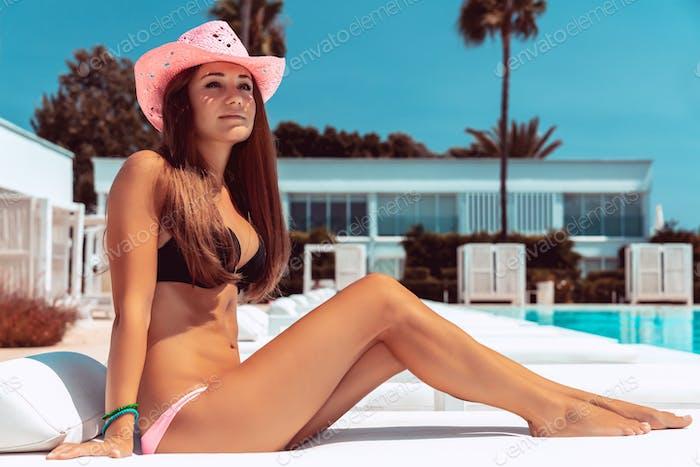 Beautiful woman on the beach resort