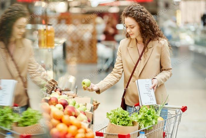 Young Woman Enjoying Grocery Shopping